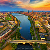 Sunset Aerial View of Boston Skyline and Charles River Esplanade from Helicopter over BU Bridge with Cambridge and Fenway