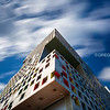 Looking Up MIT Simmons Hall Modern Architecture by Steven Holl with Blue Sky and Cloud Movement, Cambridge MA USA