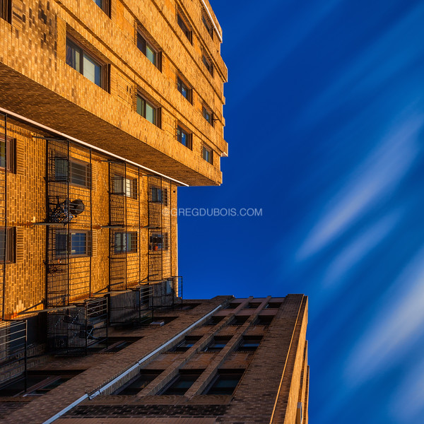 Looking Up early 20th Century Art Deco Architecture in Brighton Neighborhood Boston with Blue Sky and Gold Light on Cold Winter Afternoon