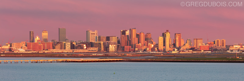 Boston Skyline and Logan Airport at Sunrise from atop Deer Island in Boston Massachusetts