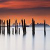 Boston Skyline through Decayed Pier at Sunset from Lovells Island in Boston Harbor