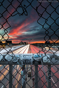 Sunset and Light Trails of Mass Pike from Overpass in Allston Neighborhood of Boston