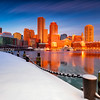 Downtown Boston Skyline over Icy Harbor and Snowy Fan Pier Harborwalk at Sunrise with Nautical Chain, South Boston Massachusetts
