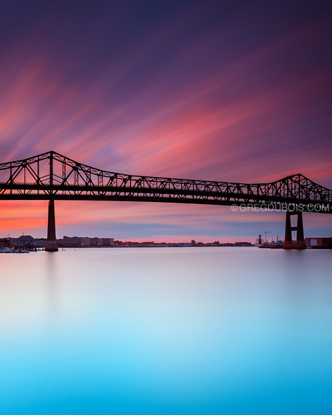 Tobin Bridge spans Mystic River into Boston at Sunrise from Chelsea Massachusetts