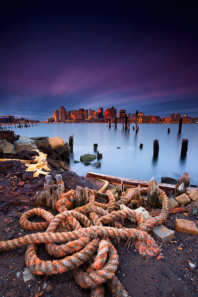 Boston Skyline from East Boston Shoreline with Nautical Rope and Decayed Pier at Sunrise