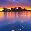 Boston Skyline Sunrise over Icy Charles River with Sunken Dinghy from Cambridge Massachusetts