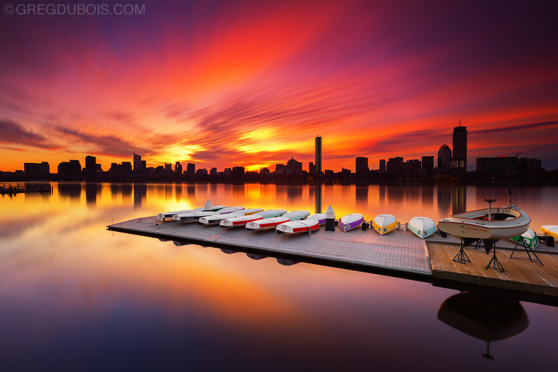 Surreal Boston Skyline Sunrise over Charles River Sailboat Dock from Cambridge Massachusetts USA