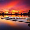 Surreal Boston Skyline Sunrise over Charles River Sailboat Dock from Cambridge Massachusetts USA