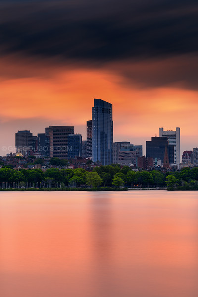 Millennium Tower and Boston Skyline with Beacon Hill at Sunset over Charles River Esplanade