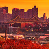 Tobin Bridge hit with Golden Light at Sunset over Fall Foliage and Chelsea Massachusetts with Downtown Boston Skyline Backdrop