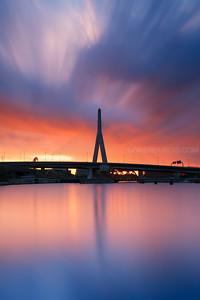 Sunrise over Zakim Bridge and Charles River Locks in Boston Massachusetts