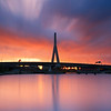Sunrise over Zakim Bridge and Charles River Locks in Boston Massachusetts