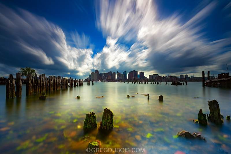 Carlton's Wharf East Boston, Boston Skyline over Boston Harbor through Decayed Pilings with Cloud Movement and Clear Water