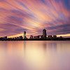 Pink and Gold Sunrise Clouds over Back Bay Boston Skyline and Charles River