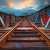 BU Bridge spans Train Tracks at Sunset in Boston Massachusetts
