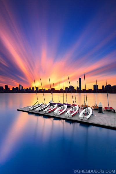 Long Exposure Cloud Stretch at Sunrise over Boston Skyline and Charles River with Sailboats