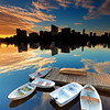 Charles River Mirror Reflection of Boston Skyline Silhouette at Sunrise with Dinghies
