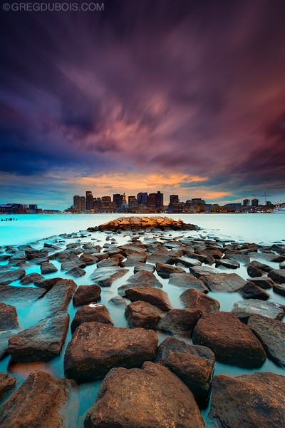 Stormy Sunset over Boston Skyline and Submerged Jetty from East Boston