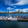 Back Bay Boston Skyline over Charles River and Sailboats with Clouds and Blue Sky from Cambridge Massachusetts USA