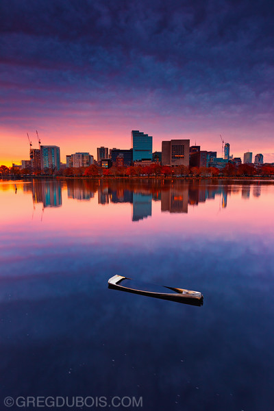 Sunken Dinghy on Charles River with West End Boston Skyline and Fall Foliage at Sunrise, Cambridge Massachusetts