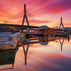 Zakim Bridge Boston Massachusetts USA, Fiery Sunrise over Charles River with Water Reflection from North Point Park Cambridge MA