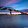 Tobin Bridge spans Mystic River into Boston in Golden Light at Sunset, Chelsea Massachusetts USA
