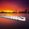 Boston Skyline Sunrise over Charles River and Snow Covered Boats from Cambridge Massachusetts USA