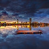 Dragon Boats on Charles River at Twilight with Boston Skyline and Mirror Reflection