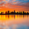Golden Sunrise over Boston Skyline Silhouette and Charles River with Mirror Reflection