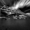 Black and White Long Exposure of Tobin Bridge spanning Mystic River into Boston with Clouds and Water Blur, Mary O'Malley Waterfront Park Chelsea Massachusett