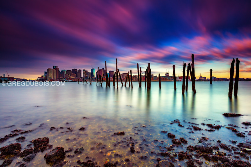 Boston Skyline Sunrise from East Boston over Boston Harbor with Decayed Pier and Clouds