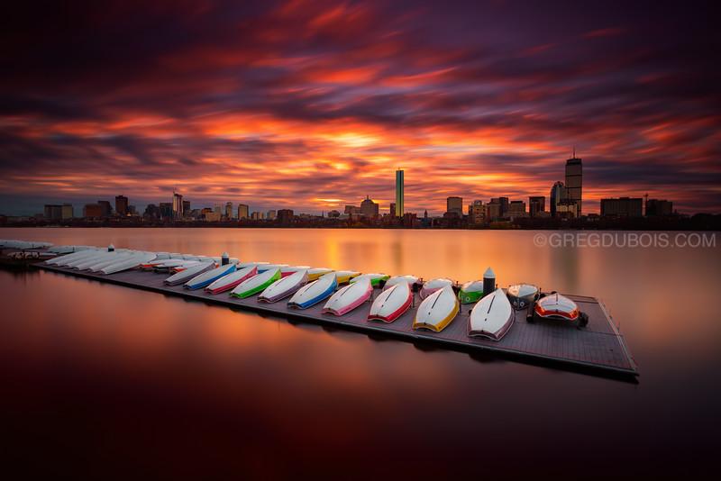 Surreal Boston Skyline Sunrise over Charles River and Sailboats from Cambridge Massachusetts USA