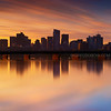 Golden Sunrise Light over Boston Skyline and Harvard Bridge with Charles River