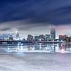 Winter Fog Rolls over Back Bay Boston Skyline, Harvard Bridge, and Icy Charles River at Night, Cambridge MA USA