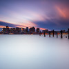 Boston Skyline Sunset with Night Lights from East Boston with Decayed Pilings