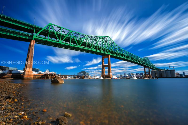Tobin Bridge spans Mystic River into Boston under Blue Sky and Clouds, Chelsea Massachusetts USA