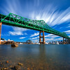 Tobin Bridge spans Mystic River into Boston under Blue Sky and Clouds, Chelsea Massachusetts USA