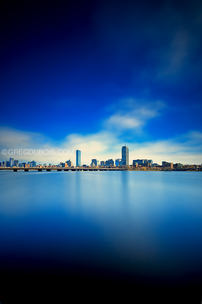 Boston Skyline and Harvard Bridge over Charles River on Blue Afternoon