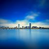 Boston Skyline and Harvard Bridge over Charles River on Blue Afternoon