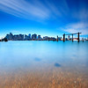 Boston Skyline over Boston Harbor from East Boston Shoreline with Blue Sky and Clouds