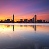 Sherbet Sunrise over Back Bay Boston Skyline and Icy Charles River - Cambridge MA USA