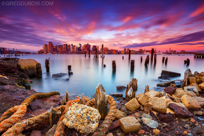 Boston Skyline Sunrise from East Boston over Boston Harbor with Decayed Pier and Old Nautical Rope