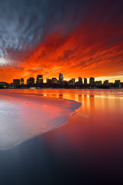 Downtown Boston Skyline and Icy Charles River with Red Sunrise