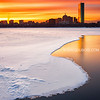 Sunrise over Snow Covered Charles River and Back Bay Boston Skyline with Hancock Tower - Cambridge MA USA