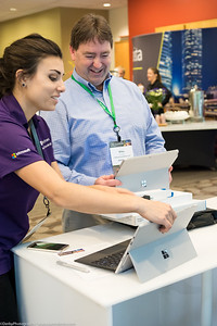 A CIO Summit attendee enjoys learning all about the new Microsoft Surface from technical support at the Enterprise and Partners Group Summit.