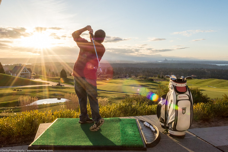Practice makes perfect!  A Microsoft CIO Summit guest enjoys practicing his golf swing at the summit's evening event.