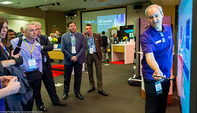 Dale Coffing, masterful support technician, shows off new devices at the Microsoft CIO Summit.