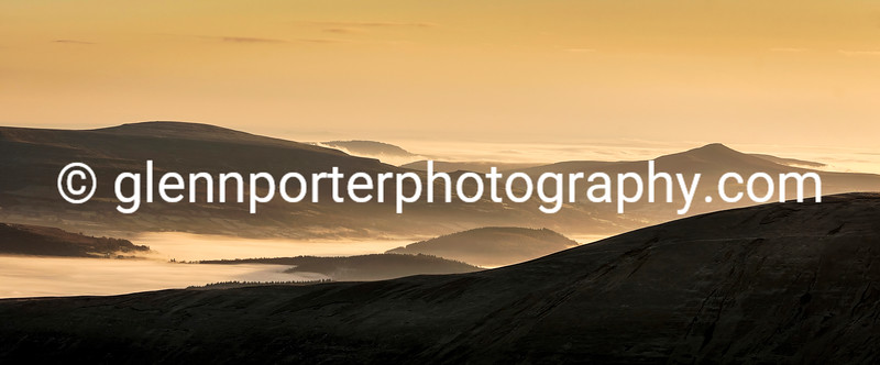 A view from Pen y Fan at sunrise towards the Black Mountains, Sugar Loaf and the Table Mountain.