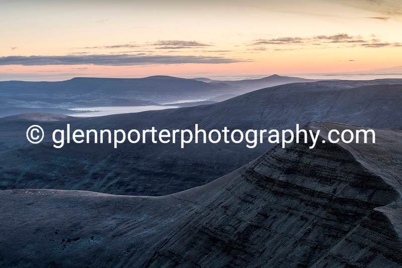 Sunrise from Pen y Fan, looking at Cribyn and the Sugar Loaf in the distance behind.
