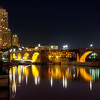 A view of Downtown Minneapolis with the Stone Arch Bridge in the foreground.